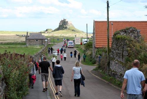 Modern day pilgrims heading for Lindisfarne Castle :Photo © 2015 David Simpson
