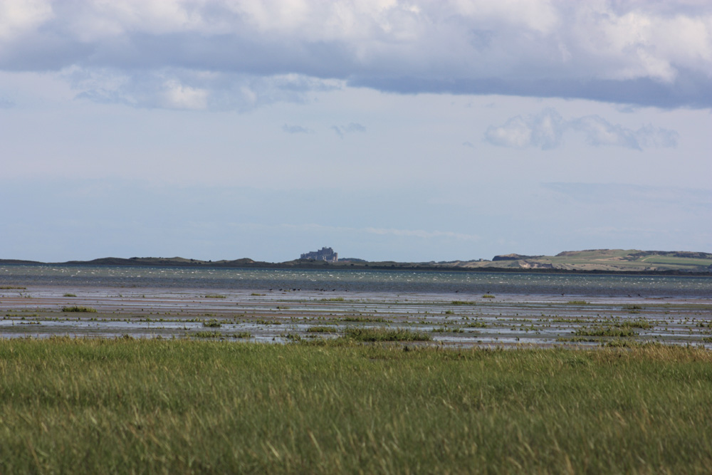 Bamburgh Castle pictured from Lindisfarne