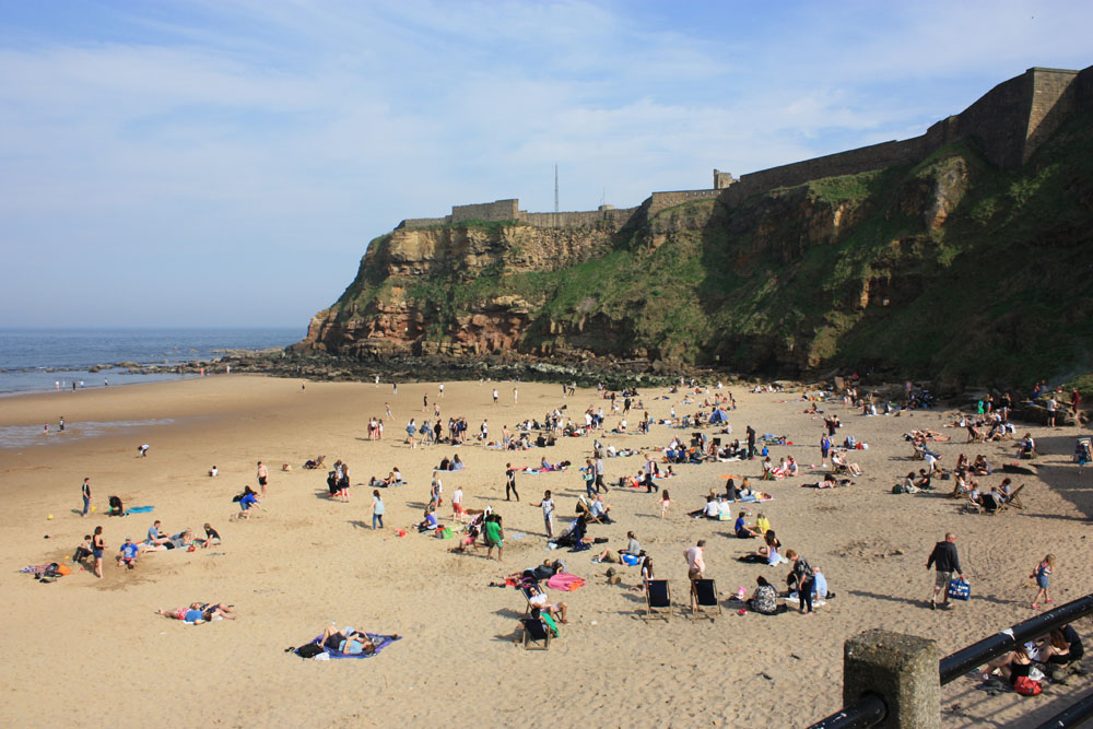 A busy beach on a sunny day at Tynemouth