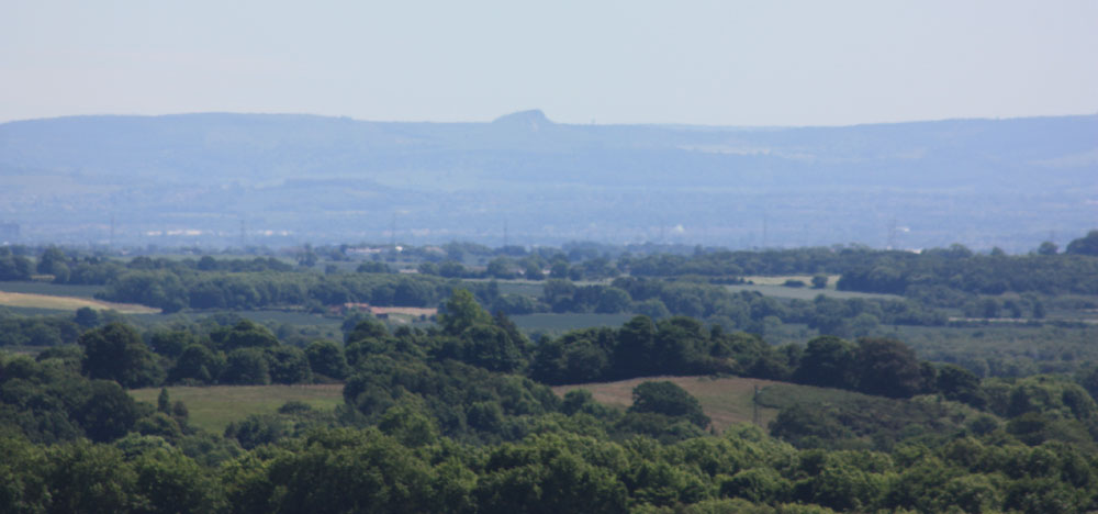 Roseberry Topping, Cleveland Hills and the Tees Vale pictured from County Durham. Photo © David Simpson 2018