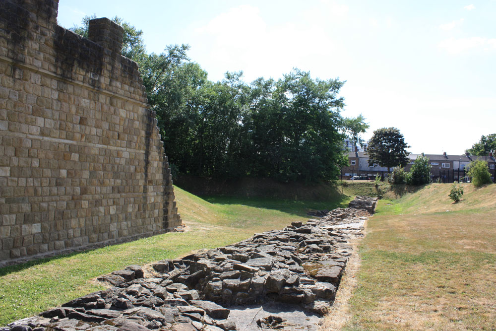 Reconstruction of Hadrian's Wall overlooking the remains of the actual wall itself near Segedunum, Wallsend.
