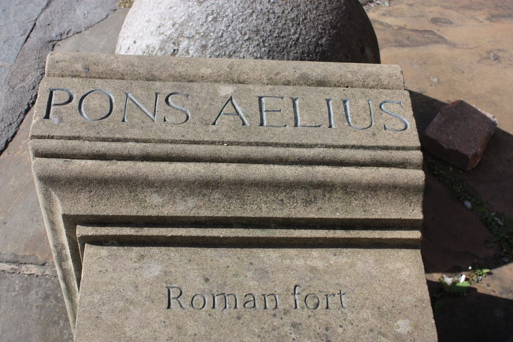 Modern stone replica commemorating the site of the Roman fort of Newcastle.