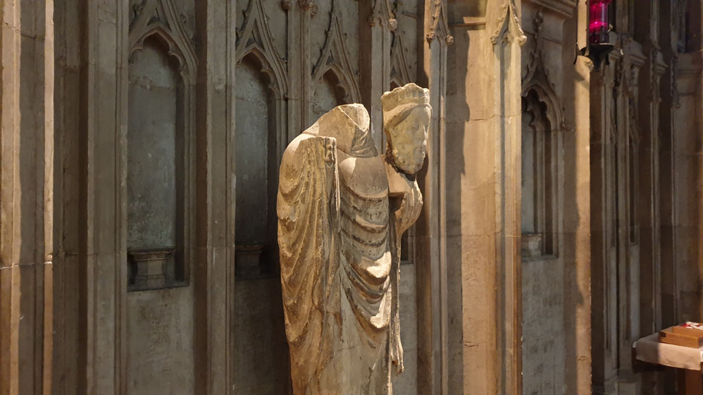 St Cuthbert holding King Oswald's head.